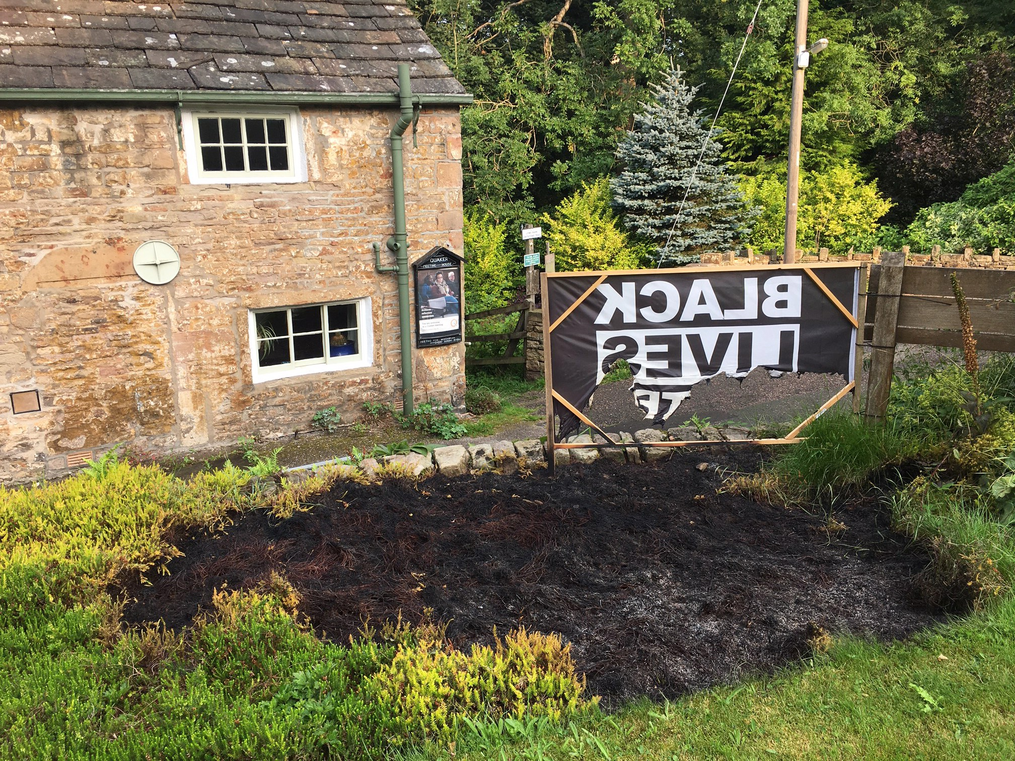 Disley Quaker Meeting BLM Banner on the morning after the fire, 11 August 2020